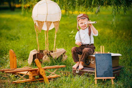 A little boy dreams of becoming a pilot. Vintage aviation hat.