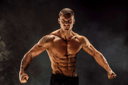 Very brawny guy bodybuilder posing. Beautiful sporty guy male power. Fitness muscled man. Roar.