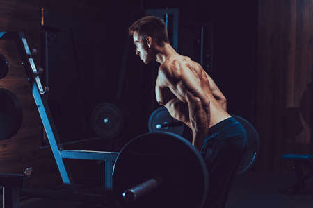 Man Doing Heavy Weight Exercise For Back. Pain and Gain.