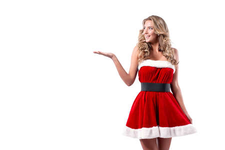 Portrait of a blonde woman dressed in red New Year costume standing isolated over white background.