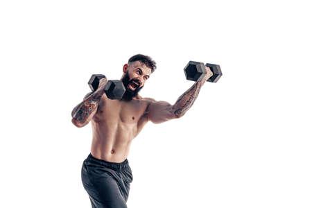 Muscular bodybuilder guy doing exercises with dumbbell over white background
