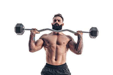Muscular bodybuilder guy doing exercises with dumbbell over white background Foto de archivo