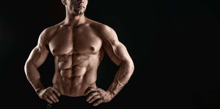 Unrecognizable Strong Athletic Sexy Muscular Man on Black Background