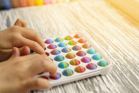 Antistress toy pop it fidget in hands 免版税图像