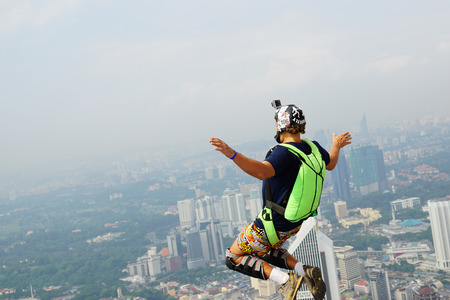 extreme angle: A BASE jumper in jumps off from KL Tower Editorial