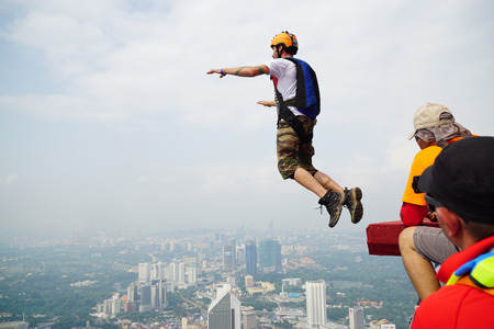 kl: A BASE jumper in jumps off from KL Tower Editorial