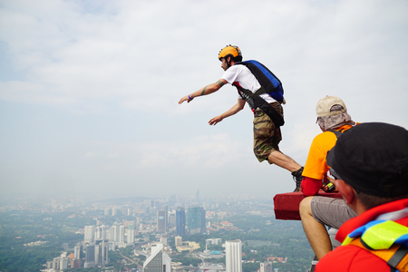 parachuting: A BASE jumper in jumps off from KL Tower Editorial