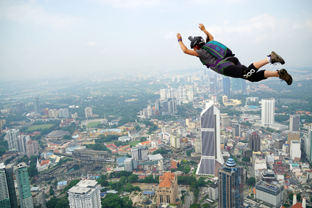 parachute jump: A BASE jumper in jumps off from KL Tower Editorial