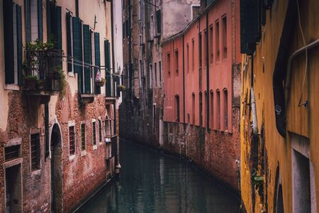 houses in a narrow street of venice
