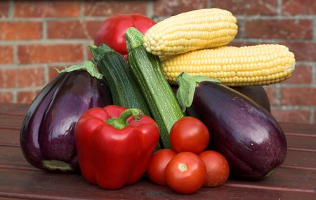 Vegetables on picnic table, fresh picked Stock Photo