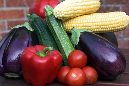 summer vegetables on picnic table against house-wall Stock Photo - 541178