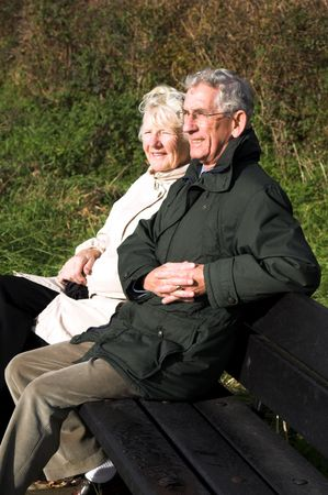 Relaxed Couple on roadside Bench photo