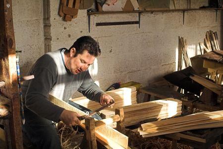 Carpenter displaying ancient local craft Stock Photo