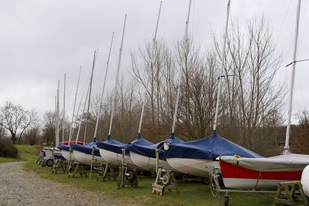 dinghies: Sailing Dinghies, abandoned for winter, on their trolleys