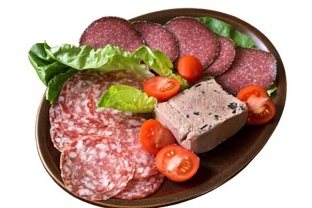 Hors d'Oeuvres platter of cold meats, truffle pate, lettuce & tomatoes Stock Photo