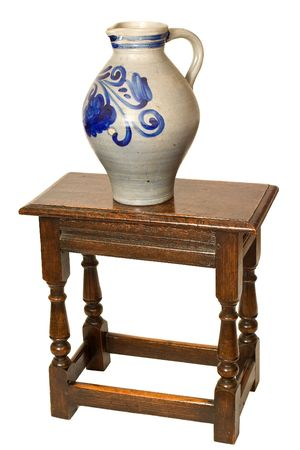 Grey Ceramic jug with traditional blue design on an old coffin stool
