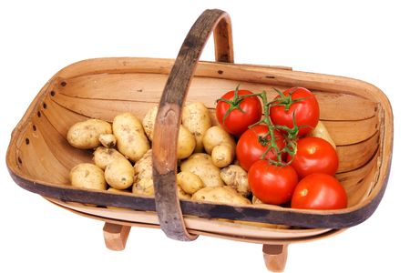 Sussex Trug with freshly dug Charlotte potatoes and early tomatoes