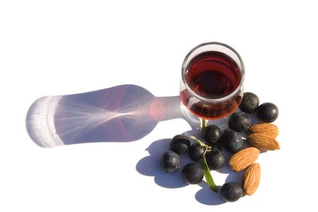 Glass of Sloe Gin with Ingredients, almonds & sloes