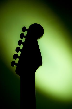 stratocaster: Stratocaster type guitar surrounded by green light