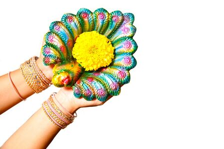 Happy Diwali - Woman hands with henna holding lit candle isolated on white background. Hindu festival of lights celebration. Copy space for text. Stockfoto