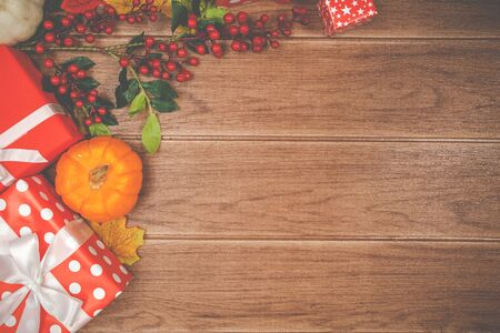 Top view of Thanksgiving concepts on wood background, Pumpkins, leaves and gift boxes, Copy space for text. Reklamní fotografie