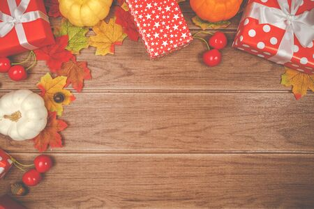 Top view of Thanksgiving concepts on wood background, Pumpkins, leaves and gift boxes, Copy space for text. Stok Fotoğraf