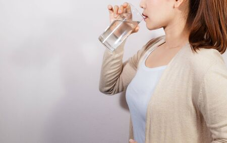 Beautiful young woman drinking a fresh glass of water, Wide Long Horizontal Banner. Body Hydration Concept. Health care concept photo, lifestyle, close up.