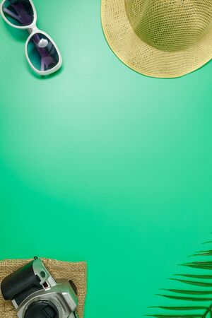 The beach accessories on the green background. Summer is coming concept. vacation and travel concept. copy space. Фото со стока