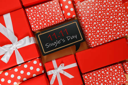 Frame of red gift boxes on yellow background with copy space for text 11.11 single's day sale. Thanksgiving day concepts, Christmas Concepts and New year concepts.