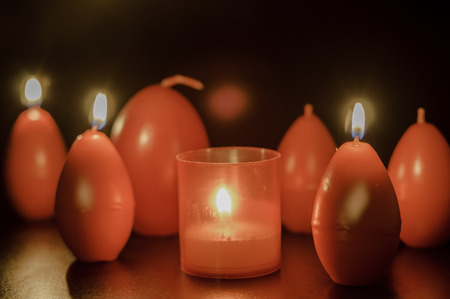 easter candle is burning: red easter egg shape candle burning