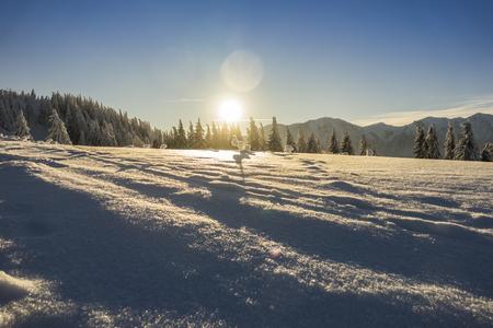 Fantastic mountain landscape glowing by sunlight. Dramatic wintry scene in Carpathians