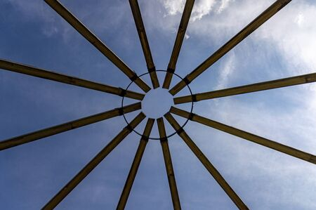 flower monument made from wood, on blue sky