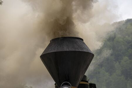 Smoke and steam from old steam train