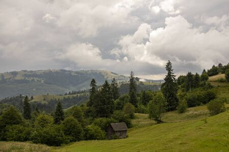 Mountains landscape from top of the mountain. Cloudy summer day Stock Photo - 129414769