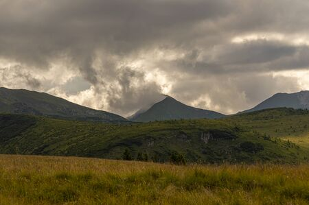 Mountains landscape from top of the mountain. Cloudy summer day Stock Photo - 129414550