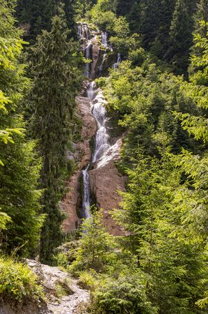 High waterfall in spring mountain Stock Photo