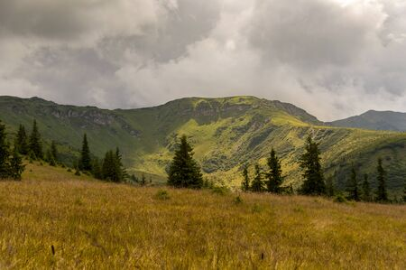 Mountains landscape from top of the mountain. Cloudy summer day Stock Photo - 129414025