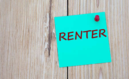 RENTER - word written on a green sheet for notes, which is pinned to a light wooden board. Business concept