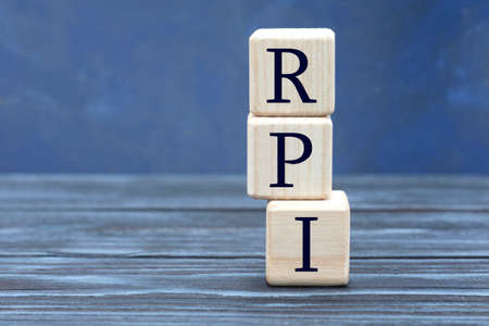 concept word RPI on cubes on a beautiful gray blue background