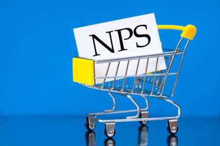 Empty consumer trolley with inscription inside -NPS. (Net Promoter Score). Business concept 版權商用圖片