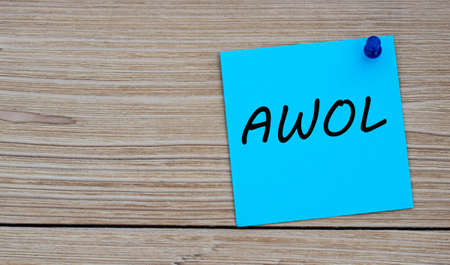 AWOL is an acronym written on a blue sheet attached to a wooden board. Busines concept. Keep it simple concept