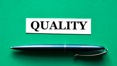 QUALITY - word on a green background with a black handle. Business concept Stock Photo