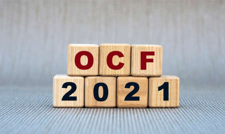 OCF (Operating Cash Flow) 2021 - word on wooden cubes on a gray background. Business and finance concept Banque d'images