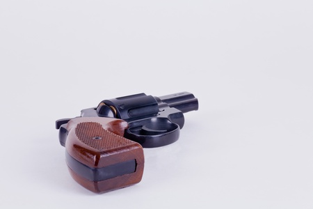 arma: revolver calibre 38 mm