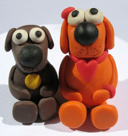 diminutive: A plasticine toys. Handmade. The little funny dogs on the white background.