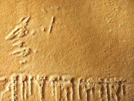 embossed paper: Yellowish background of embossed paper wallpaper. Macro Stock Photo