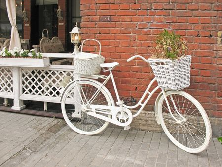 Detail design summer cafe with a bicycle, painted white