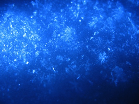 Blue snow. Macro. Snow surface, illuminated by a blue lantern Stock Photo