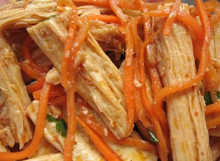 rubbery: Chinese Dried Tofu Skin. Stick form, as a dish