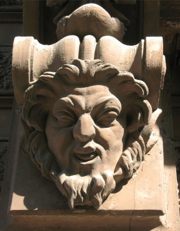 satire: The head is a satire on the facade of the building. The element of decor.